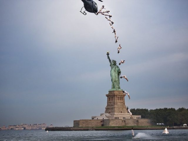 Red Bull Cliff Diver Leaps for Lady Liberty